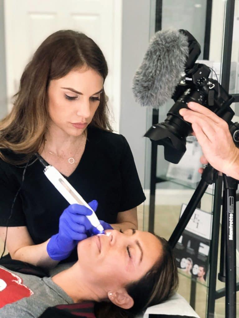 Candice providing skin care treatment